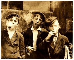 Lewis_Hine,_Newsies_smoking_at_Skeeter's_Branch,_St._Louis,_1910